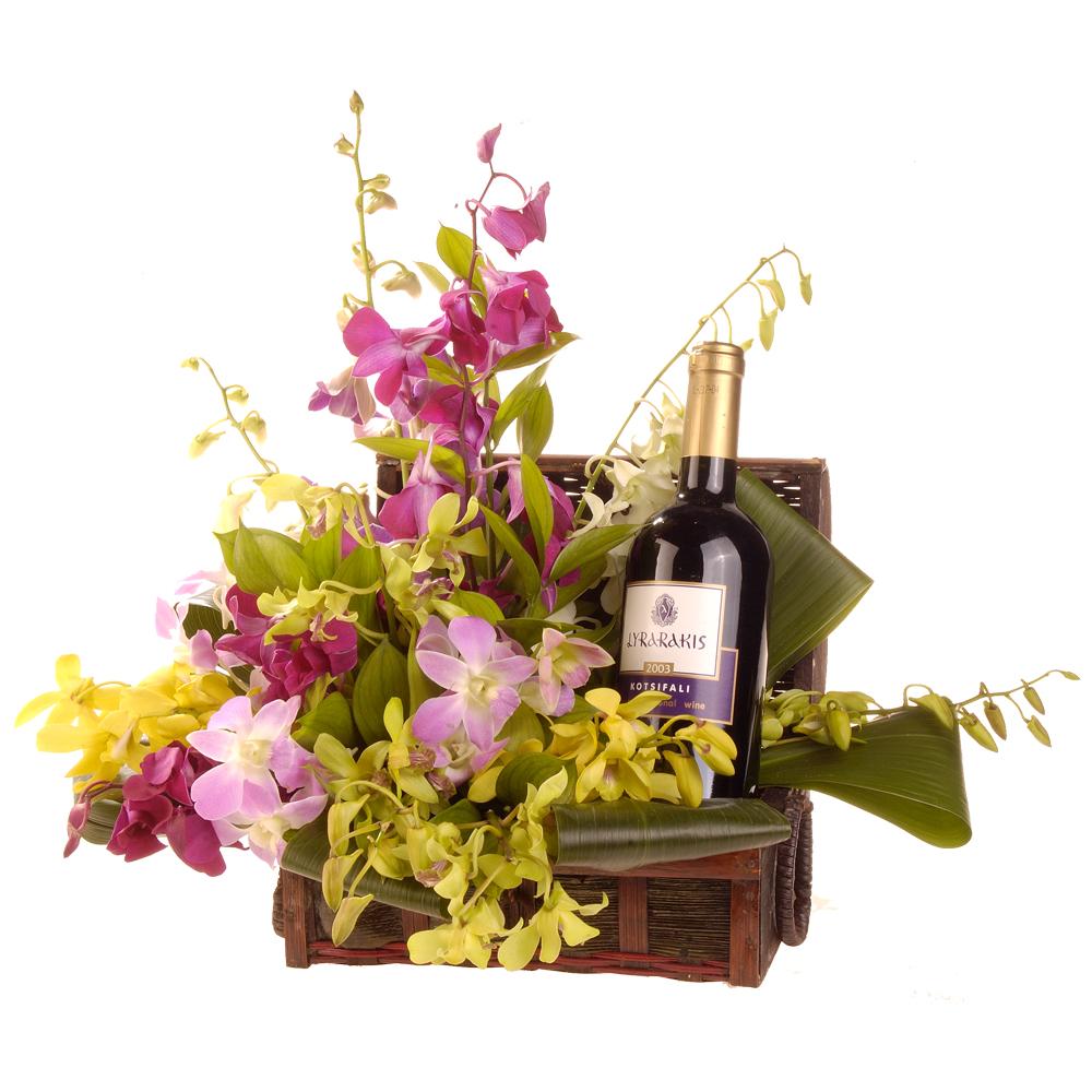 Βαλιτσάκι με ορχιδέες και κρασί