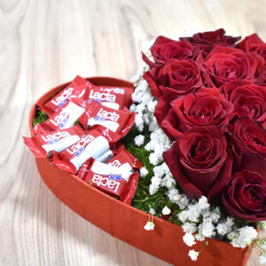 Heart with red roses  and chocolates