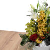 Orchid arrangement with wine
