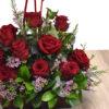 Βαλίτσα με κόκκινα τριαντάφυλλα